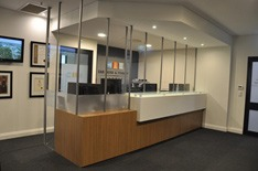 Custom built perspex screen for reception desk